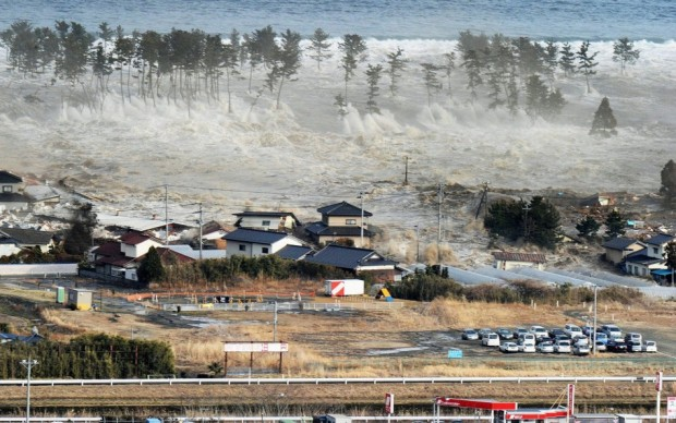 An aerial photo shows a residential area being hit by a tsunami in Natori, Miyagi prefecture on March 11, 2011.
