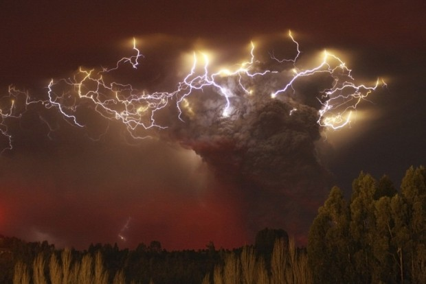 Lightning flashes around the ash plume at above the Puyehue-Cordon Caulle volcano chain near Entrelagos June 5, 2011. The volcano in the Puyehue-Cordon Caulle chain, dormant for decades, erupted in south-central Chile on Saturday, belching ash over 6 miles (10 km) into the sky, as winds fanned it toward neighboring Argentina, and prompted the government to evacuate several thousand residents, authorities said. Picture taken June 5.  Source: Reuters
