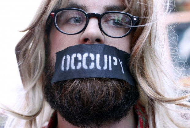 An Occupy Wall Street protester joins a demonstration at Times Square, New York, Oct. 15, 2011. Thousands of anti-Wall Street protesters rallied in New York's Times Square on Saturday, buoyed by a global day of demonstrations in support of their month-long campaign against corporate greed.  Source: Reuters