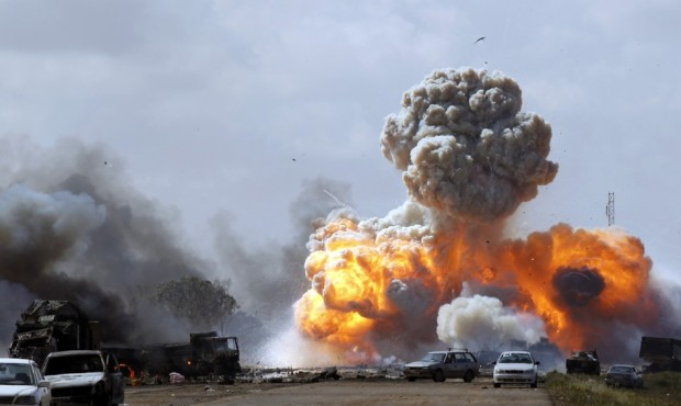 Vehicles belonging to forces loyal to Libyan leader Moammar Gadhafi explode after an air strike by coalition forces, along a road between Benghazi and Ajdabiyah March 20, 2011.  Source: Reuters