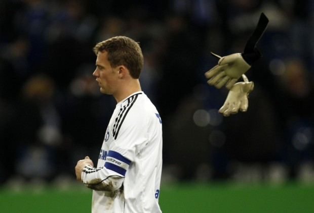 Schalke 04's goalkeeper Manuel Neuer throws away his gloves during the German Bundesliga soccer match against Hamburg SV in Gelsenkirchen Jan. 15, 2011. Hamburg won the match 1-0.  Source: Reuters
