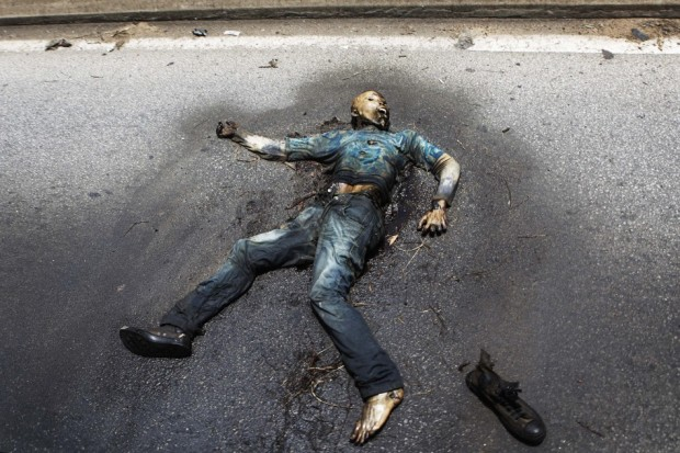VISUALS COVERAGE OF SCENES OF DEATH AND INJURY A decomposing body lies on a road in Abidjan April 14, 2011. Ivory Coast's Laurent Gbagbo was overthrown by Ivorians, not by foreign powers, the United Nations said on Thursday amid rising criticism of its role in the removal of the former leader.