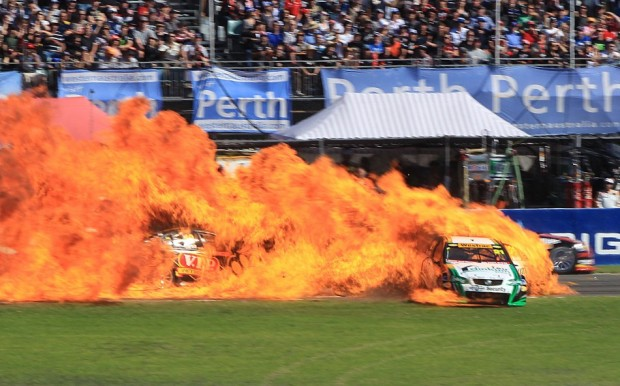 Australian V8 Supercar driver Karl Reindler's car (2-R) bursts into flames after a collision with another race car (L) driven by Steve Owen during competition at Barbagallo Raceway in Perth May 1, 2011. Both drivers walked away from the crash with Reindler being taken to hospital with burns to his hands, local media reported.  Source: Reuters