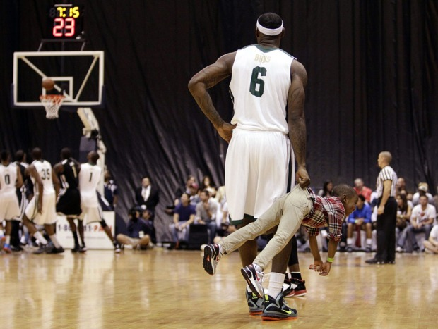 Miami Heat's LeBron James holds his son, Bryce, during the second half of the South Florida All-Star Classic NBA basketball game, on October 8, 2011, in Miami. (AP Photo/J Pat Carter)