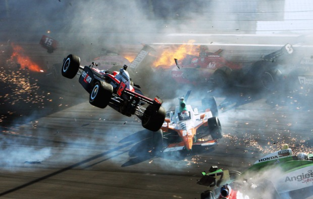 The race car of driver Will Power (left) goes airborne during a multiple-car crash at the IZOD IndyCar World Championship race at the Las Vegas Motor Speedway in Las Vegas, Nevada, on October 16, 2011. The motor racing world was left reeling from the death of time-two Indianapolis 500 champion Dan Wheldon, who was killed in the crash, as the season-ending celebration turned to disaster. (Reuters/Barry Ambrose)