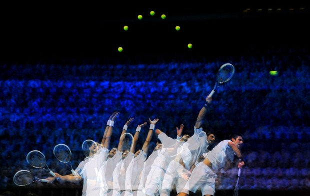 A multiple-exposure image of Novak Djokovic of Serbia, as he serves during the men's singles match against Janko Tipsarevic of Serbia during the Barclays ATP World Tour Finals at the O2 Arena in London, England, on November 25, 2011. (Michael Regan/Getty Images for Barclays)