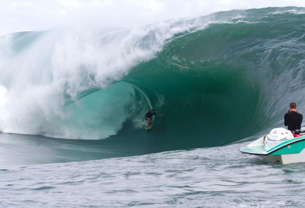 Air Tahiti Nui wildcard trialist Anthony Wals of Lennox Head, Australia, rides a massive barrel during a tow-in surfing session at Teahupo'o, Tahiti, on August 27, 2011. (AP Photo/ASP, Kirstin Scholtz)