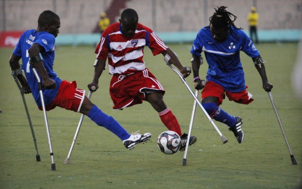 Soccer players from Haiti's Zaryen team (in blue) and the national amputee team fight for the ball during a friendly match at the national stadium in Port-au-Prince, Jan. 10, 2011. Sprinting on their crutches at breakneck speed, the young soccer players, who lost their legs in Haiti's earthquake last year, project a symbol of hope and resilience in a land where so much is broken.  Source: Reuters