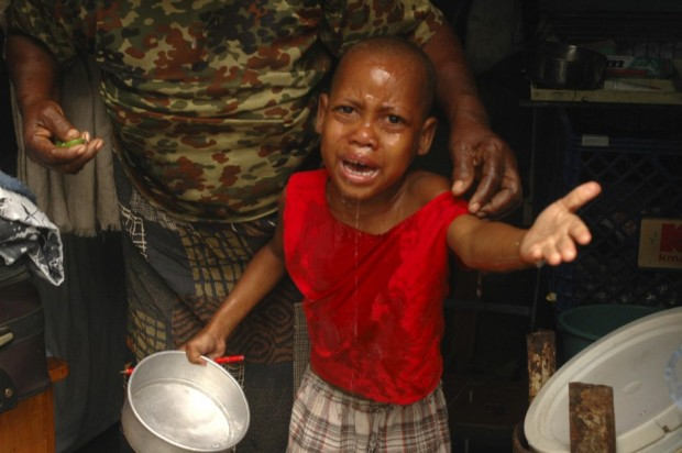 A boy cries after breathing in tear gas thrown by national policemen in a provisional camp for earthquake victims during clashes with demonstrators in downtown Port-au-Prince, Feb. 7, 2011. Around 200 protesters demanding that Haiti's outgoing President Rene Preval leave office immediately, set up burning barricades on Monday and threw stones at the police and U.N. peacekeepers in the capital Port-au-Prince, witnesses said.  Source: Reuters